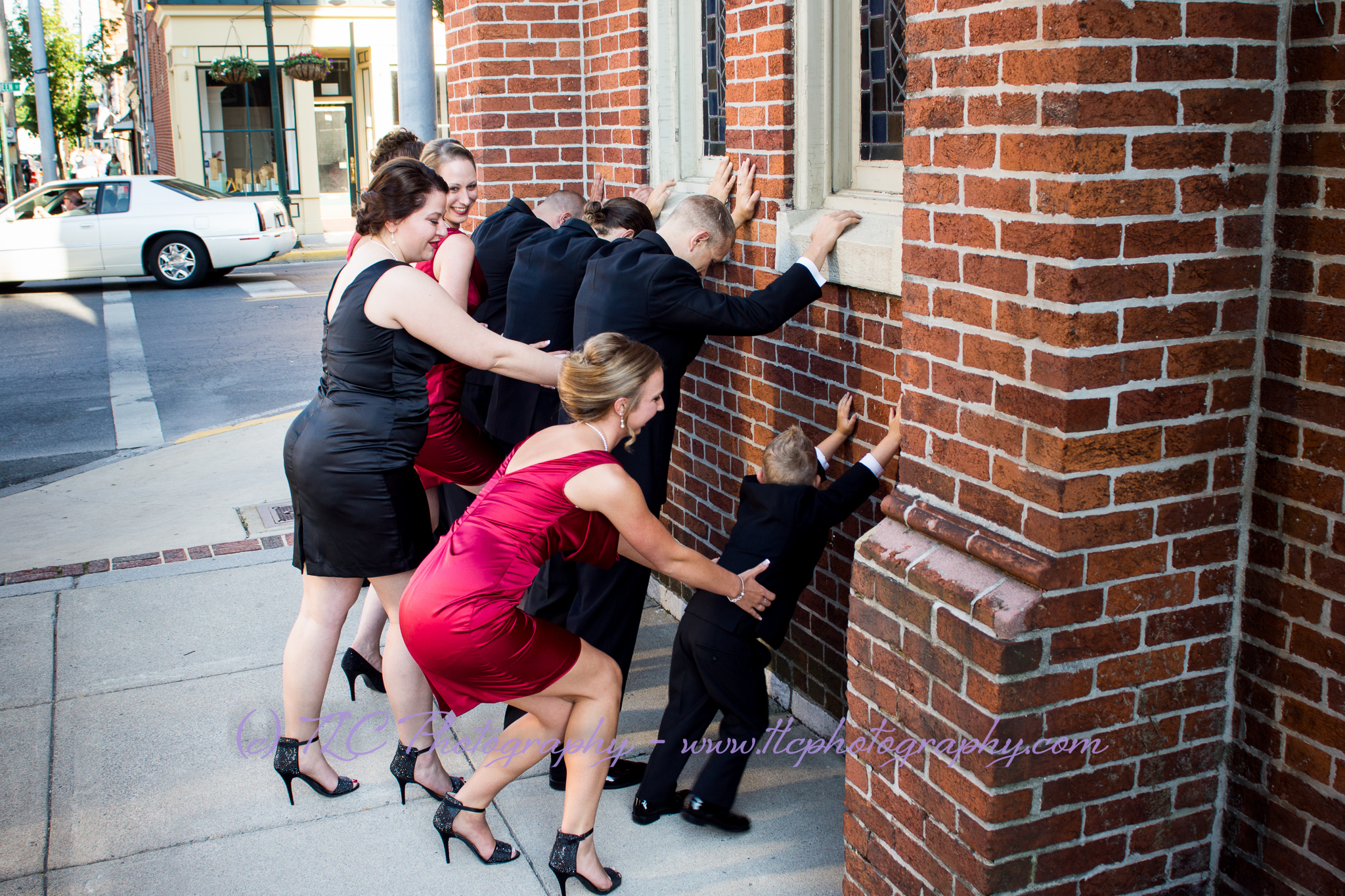 Hijinks on the sidewalk at Kayla and Cody's wedding