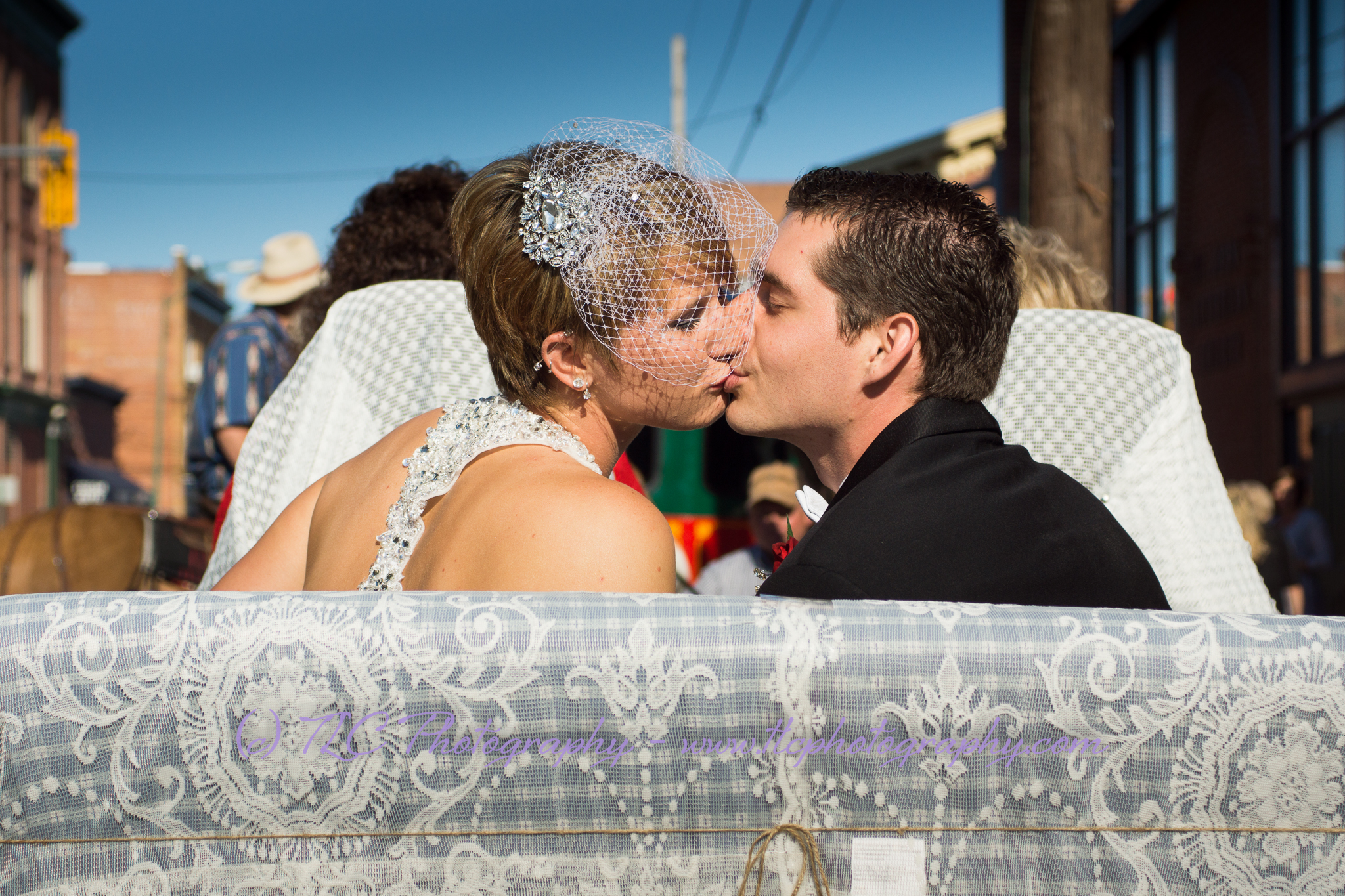 Another kiss before the horse and carriage ride to McFarland House in Martinsburg