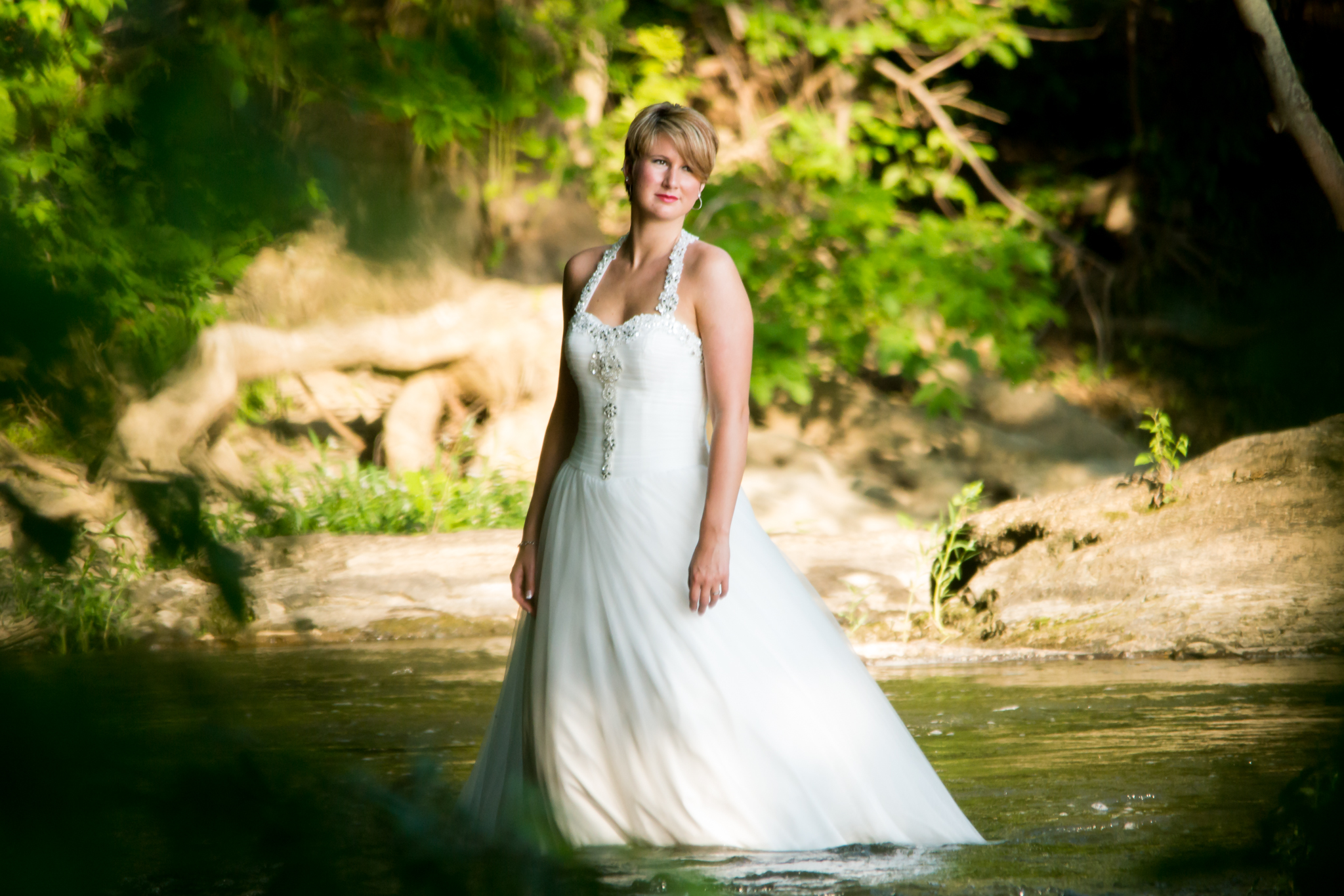 Water shoot with a wedding dress on.